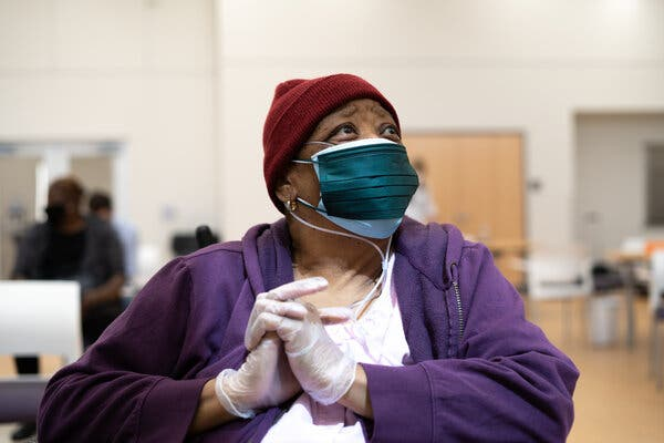 """Flossie West, 73, at the East Baton Rouge Council on Aging after receiving a shot of the coronavirus vaccine. """"I'm just not interested because everyone tells me the virus is a hoax,"""" she had said earlier."""