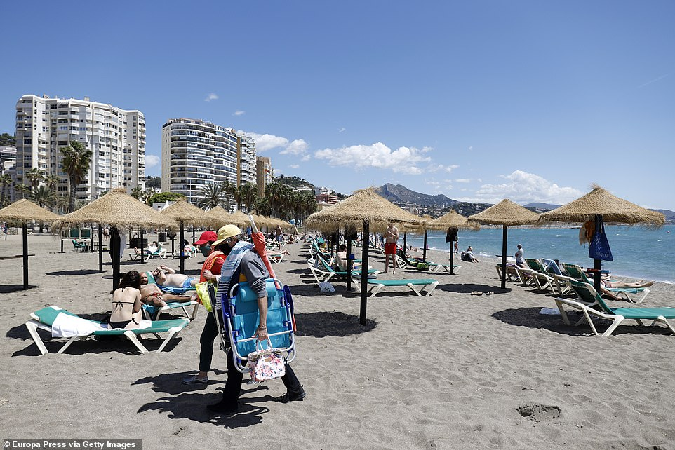 Boris Johnson is today facing pressure from ministers to expand the travel 'green list' and give millions of Britons hopes of a holiday abroad this summer. Pictured: A beach in Malaga, Spain